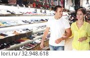 Купить «Young couple walking in clothing store», видеоролик № 32948618, снято 19 февраля 2020 г. (c) Яков Филимонов / Фотобанк Лори