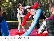 Купить «Two women at amusement park», фото № 32951158, снято 8 апреля 2020 г. (c) Яков Филимонов / Фотобанк Лори