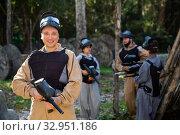 Man and his paintball sport team. Стоковое фото, фотограф Яков Филимонов / Фотобанк Лори