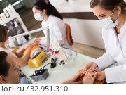 Nail technicians performing manicure. Стоковое фото, фотограф Яков Филимонов / Фотобанк Лори