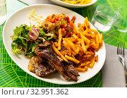 Купить «Grilled of lamb served with french fries and vegetable garnish», фото № 32951362, снято 31 марта 2020 г. (c) Яков Филимонов / Фотобанк Лори