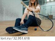 Female player legs, squash racket and ball. Стоковое фото, фотограф Tryapitsyn Sergiy / Фотобанк Лори