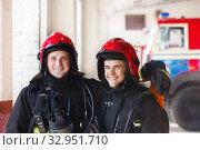 Купить «young firefighters on the background of fire engines», фото № 32951710, снято 21 октября 2019 г. (c) Майя Крученкова / Фотобанк Лори