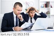 Купить «Two worried males coworkers in firm office», фото № 32953518, снято 31 мая 2020 г. (c) Яков Филимонов / Фотобанк Лори