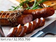 Купить «Sliced half-smoked sausages on wooden table», фото № 32953766, снято 29 февраля 2020 г. (c) Яков Филимонов / Фотобанк Лори