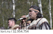 Itelmen shaman sings song throat singing in traditional clothing of aboriginal people of Kamchatka. Itelmens national ritual festival thanksgiving nature Alhalalalay. Kamchatka Peninsula (2019 год). Редакционное видео, видеограф А. А. Пирагис / Фотобанк Лори