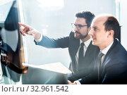 Купить «Business team analyzing data at business meeting in modern corporate office.», фото № 32961542, снято 10 января 2020 г. (c) Matej Kastelic / Фотобанк Лори