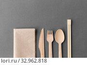 Купить «wooden spoon, fork, knife and chopsticks», фото № 32962818, снято 3 мая 2019 г. (c) Syda Productions / Фотобанк Лори