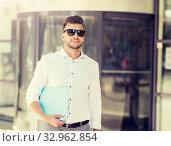 Купить «young man with business file on city street», фото № 32962854, снято 21 августа 2016 г. (c) Syda Productions / Фотобанк Лори