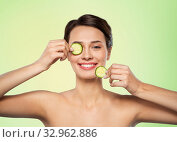 Купить «beautiful woman making eye mask of cucumbers», фото № 32962886, снято 30 ноября 2019 г. (c) Syda Productions / Фотобанк Лори