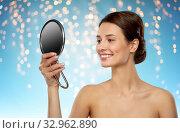 Купить «beautiful young woman looking to mirror», фото № 32962890, снято 30 ноября 2019 г. (c) Syda Productions / Фотобанк Лори