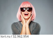 Купить «happy woman in pink wig and black sunglasses», фото № 32962954, снято 30 сентября 2019 г. (c) Syda Productions / Фотобанк Лори