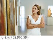 Купить «Woman visiting painting exhibition», фото № 32966594, снято 28 июля 2018 г. (c) Яков Филимонов / Фотобанк Лори