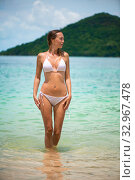 Young slim beautiful girl stay and posing in the sea or ocean waves. Стоковое фото, фотограф katalinks / Фотобанк Лори