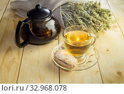 Herbal tea in a glass cup and cake on a table close-up. Стоковое фото, фотограф Татьяна Ляпи / Фотобанк Лори