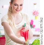 Купить «Young woman watering plants in her garden», фото № 32971562, снято 11 апреля 2018 г. (c) Elnur / Фотобанк Лори