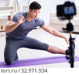 Купить «Sports and health blogger recording video in sport concept», фото № 32971934, снято 3 мая 2017 г. (c) Elnur / Фотобанк Лори