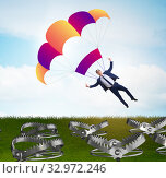 Купить «The businessman falling into trap on parachute», фото № 32972246, снято 8 апреля 2020 г. (c) Elnur / Фотобанк Лори