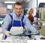 Купить «Active male engaged on industrial machine», фото № 32972522, снято 10 сентября 2018 г. (c) Яков Филимонов / Фотобанк Лори