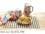 Layer cake with cheese, jug and cup of milk on a table close-up. Стоковое фото, фотограф Татьяна Ляпи / Фотобанк Лори