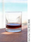 Купить «Glass of spiced dark Caribbean rum, vertical close up», фото № 32972866, снято 15 января 2020 г. (c) EugeneSergeev / Фотобанк Лори