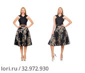 Купить «Woman in floral dark skirt isolated on white», фото № 32972930, снято 29 декабря 2014 г. (c) Elnur / Фотобанк Лори
