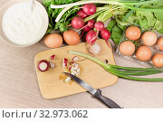 Fresh vegetables and eggs for making salad on the table close-up. Стоковое фото, фотограф Татьяна Ляпи / Фотобанк Лори