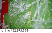 Купить «A person splashes bright yellow color paint on the wall», видеоролик № 32973354, снято 2 июня 2020 г. (c) Константин Шишкин / Фотобанк Лори
