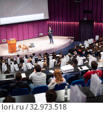 Купить «Speaker giving presentation on business conference event.», фото № 32973518, снято 18 октября 2019 г. (c) Matej Kastelic / Фотобанк Лори