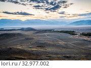 Morning in the Kurai steppe, dirt road through the hills. Kosh-Agachsky District, Altai Republic, Russia. Стоковое фото, фотограф Вадим Орлов / Фотобанк Лори