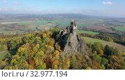 Купить «Impressive autumn landscape of Bohemian Paradise overlooking ruins of medieval Trosky Castle on tops of two stone crags, Czech Republic», видеоролик № 32977194, снято 18 октября 2019 г. (c) Яков Филимонов / Фотобанк Лори