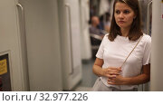 Купить «Portrait of young smiling woman standing in subway car hold on handrail», видеоролик № 32977226, снято 19 сентября 2019 г. (c) Яков Филимонов / Фотобанк Лори
