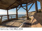 Купить «View from the hut to the rocky shore of the sea», фото № 32982234, снято 13 октября 2018 г. (c) Иванов Алексей / Фотобанк Лори