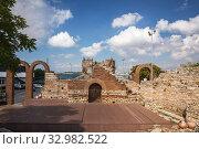 Купить «Ruins of an ancient theatre in Nessebar, Bulgariar», фото № 32982522, снято 26 июня 2019 г. (c) Юлия Бабкина / Фотобанк Лори