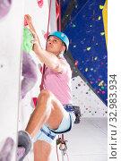 Купить «Male on climbing wall with safety belts», фото № 32983934, снято 9 июля 2018 г. (c) Яков Филимонов / Фотобанк Лори