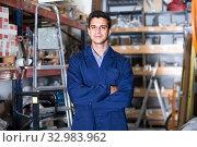 Portrait of smiling male in uniform on his workplace in building store. Стоковое фото, фотограф Яков Филимонов / Фотобанк Лори
