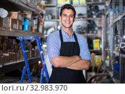 Portrait of handsome male in uniform on his workplace in building store. Стоковое фото, фотограф Яков Филимонов / Фотобанк Лори