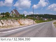 Купить «Landscape with a village and a road in the north Montenegro», фото № 32984390, снято 14 июня 2019 г. (c) Володина Ольга / Фотобанк Лори