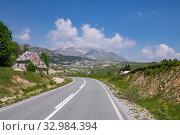 Купить «Landscape with a village and a road in the north Montenegro», фото № 32984394, снято 14 июня 2019 г. (c) Володина Ольга / Фотобанк Лори
