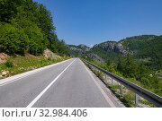 Купить «Landscape with road in the north Montenegro», фото № 32984406, снято 14 июня 2019 г. (c) Володина Ольга / Фотобанк Лори