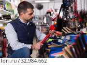 Adult man is buying new adjustable wrench. Стоковое фото, фотограф Яков Филимонов / Фотобанк Лори