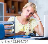 Купить «Upset female employee at workplace», фото № 32984754, снято 10 июля 2020 г. (c) Яков Филимонов / Фотобанк Лори