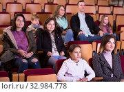 Купить «Audience in cold season in cinema», фото № 32984778, снято 3 декабря 2016 г. (c) Яков Филимонов / Фотобанк Лори