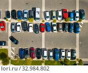 Купить «Top view of wide road with markings and lots of cars at day», фото № 32984802, снято 20 июня 2019 г. (c) Яков Филимонов / Фотобанк Лори