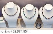 Купить «Necklace from natural stones in a jewelry store», фото № 32984854, снято 17 февраля 2020 г. (c) Яков Филимонов / Фотобанк Лори