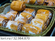 Купить «Fresh bake cinnamon roll with custard on a store counter. Traditional Russian pastries», фото № 32984870, снято 3 апреля 2020 г. (c) Яков Филимонов / Фотобанк Лори