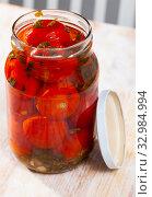 Купить «Tomatoes marinated in jars on a wooden table», фото № 32984994, снято 26 февраля 2020 г. (c) Яков Филимонов / Фотобанк Лори