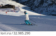 Купить «Young adult sportswoman in a ski suit and helmet skiing on an empty ski slope in the Dolomites, Livigno Italy», видеоролик № 32985290, снято 27 января 2020 г. (c) Алексей Кузнецов / Фотобанк Лори