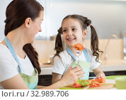 Child cooking with her mother. Стоковое фото, фотограф Оксана Кузьмина / Фотобанк Лори