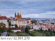 Купить «Night falls at Hradcany Castle, Prague, Czechia.», фото № 32991270, снято 28 сентября 2019 г. (c) age Fotostock / Фотобанк Лори